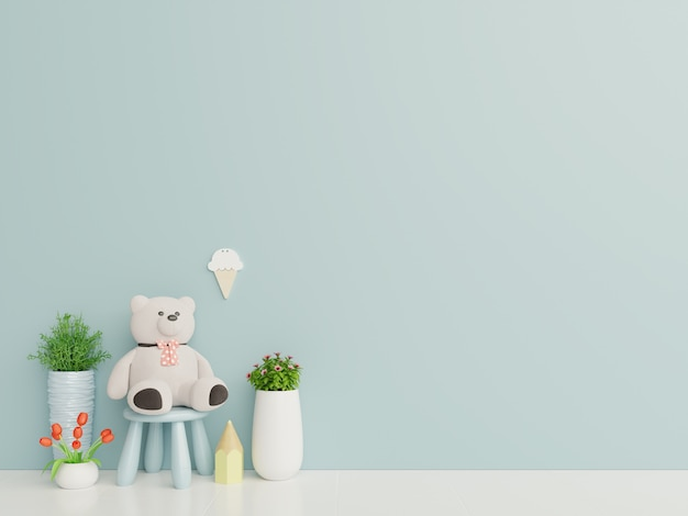Teddy bear in the children's room on blue wall background.