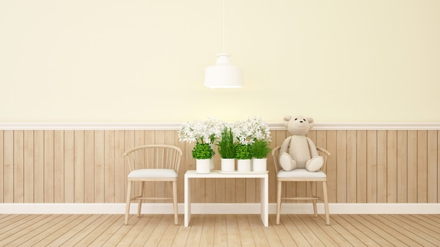 Teddy bear and flower in yellow room