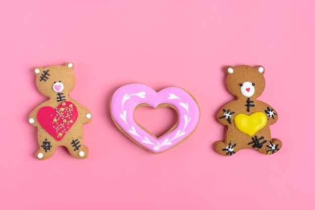 Teddy bear gingerbread heart on pink background