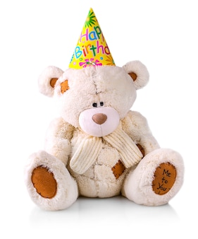 Teddy bear in a hat with the inscription