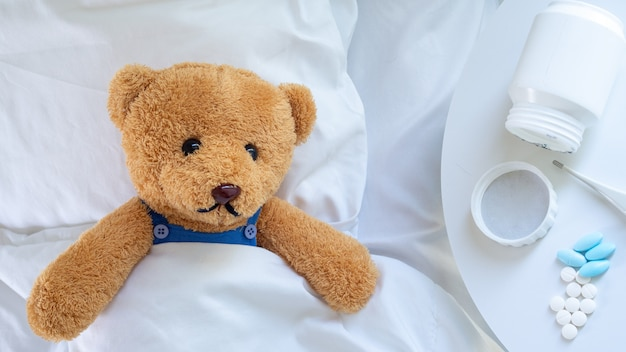 Teddy bear is ill from the flu and virus infection