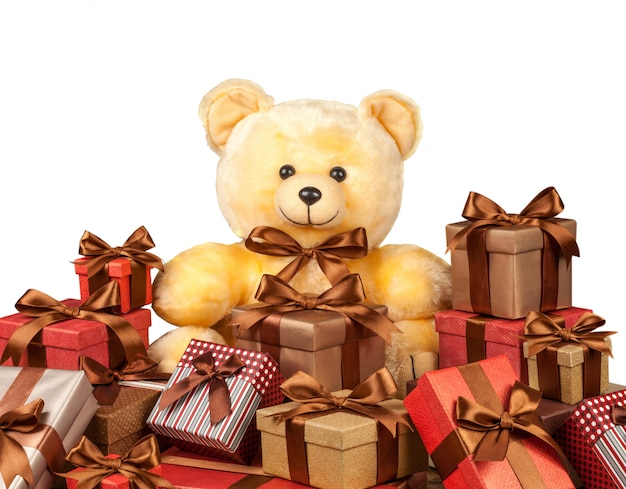 Teddy bear and a lot of boxes with gifts