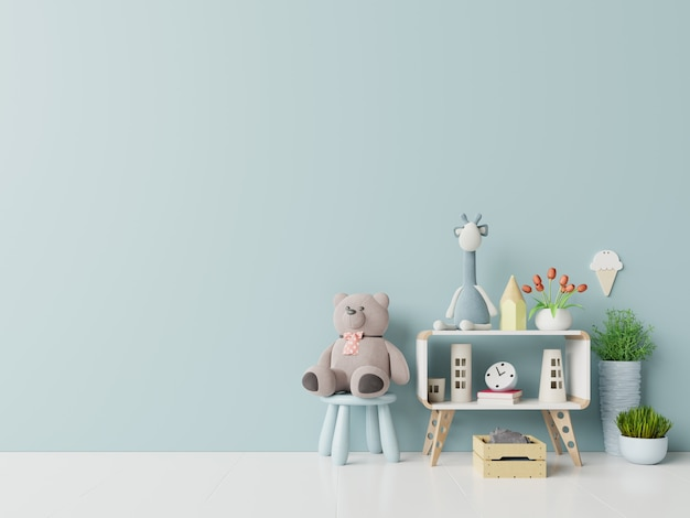 Teddy bear and rabbit doll in the children's room on blue wall background.