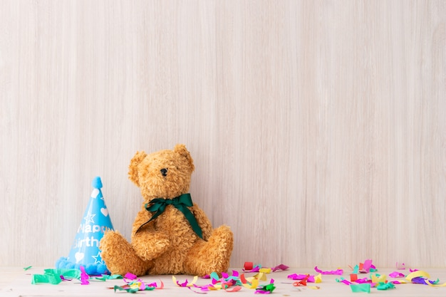 Teddy bear on a romactic party table shelf copy space