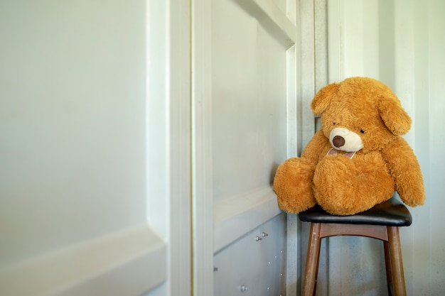 Teddy bear sitting lonely waiting for something back.