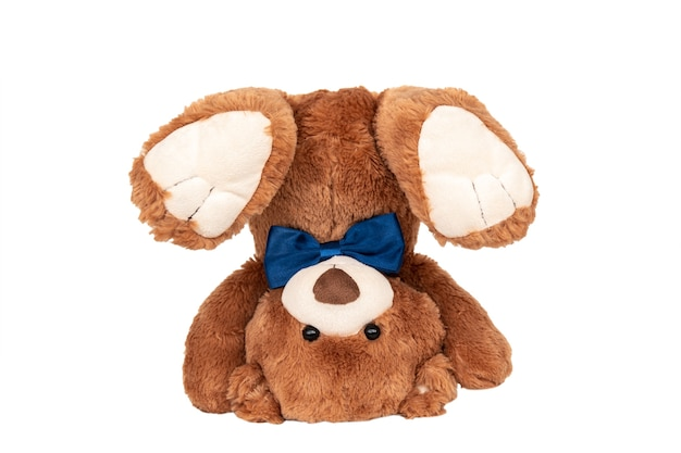Teddy bear turned upside down with blue bow
