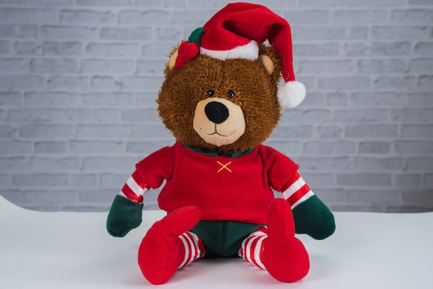 Teddy bear wearing chrismas shirt isolated on a gray background
