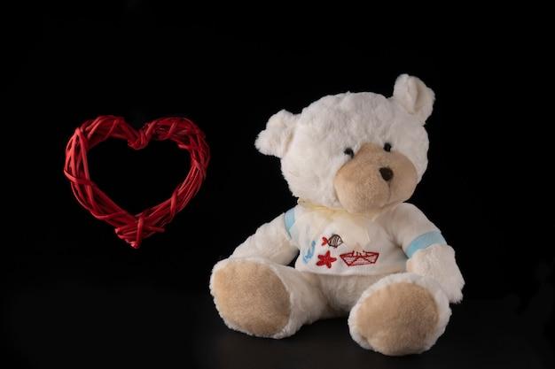 Teddy bear with big wicker heart