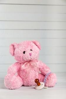Teddy bear with dummy