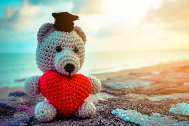 Teddy bear with red heart sitting