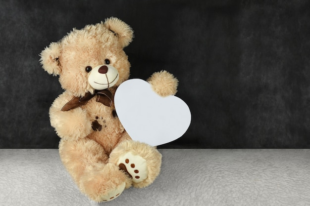 Teddy bear with red hearts wishes you a happy valentine's day