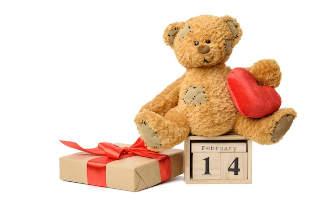 Teddy bear and wooden calendar with date 14 february and box with a gift on white, valentine's day