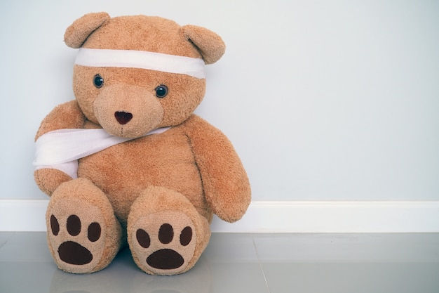 Teddy bears have gauze, wound on the arms and head. child injury concept