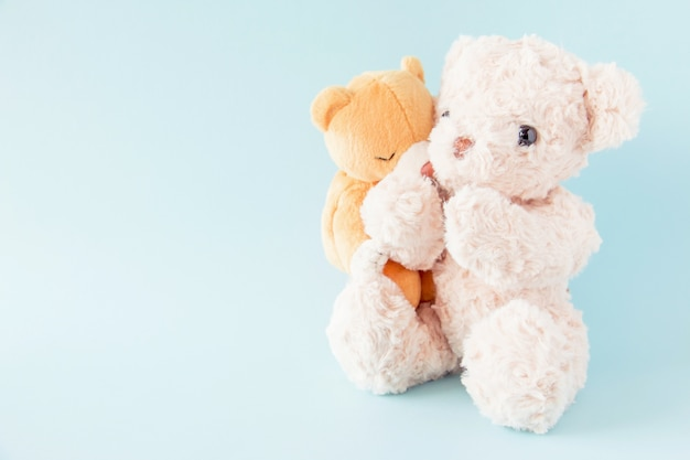 Teddy bears on pastel background ,the couple doll are happy in relationship is lover