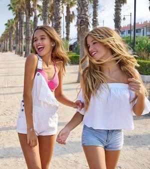 Teen best friends girls walking happy