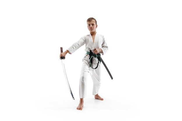Teen boy fighting at aikido training in martial arts school