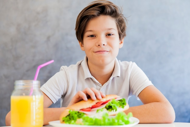 Teen boy having breakfast at home