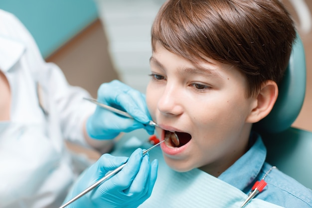 Teen boy having dental treatment healthy teeth dental care concept