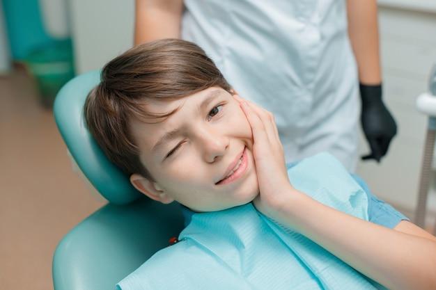 Teen boy having dental treatment healthy teeth dental care concept Premium Photo