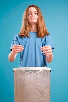 Teen boy posed over shredder