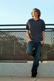 Teen boy on sidewalk