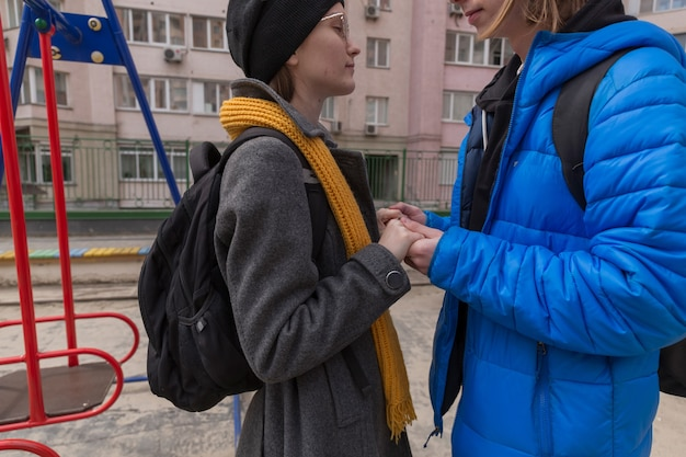 Teen boy and teen girl on a walk in bright clothes relationship concept during puberty