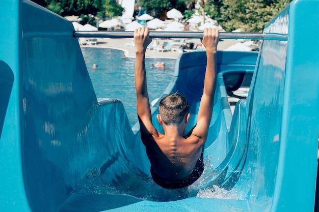 Teen boy at water slides