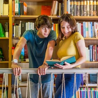 Teen couple reading book