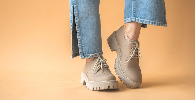 Teen girl in casual sneakers. hipster shoes on women feet in denim clothes. lifestyle and trendy design background photo