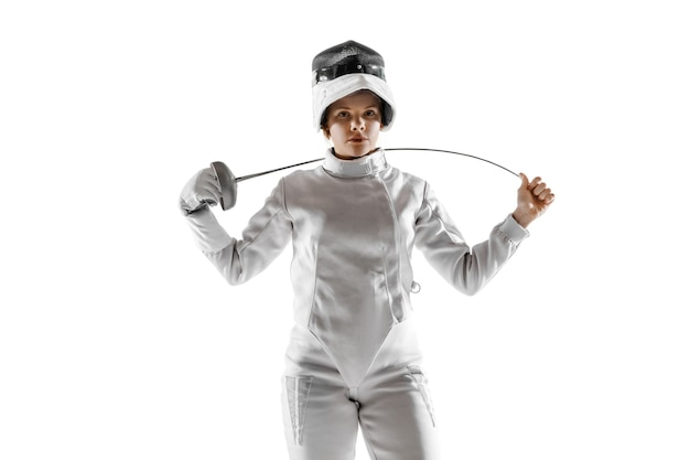 Teen girl in fencing costume with sword in hand isolated on white  background.