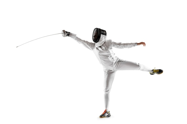 Teen girl in fencing costume with sword in hand isolated on white background