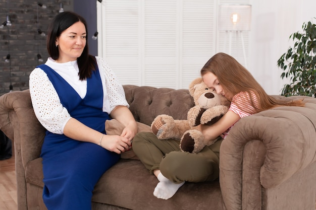 Teen girl on reception at the psychotherapist