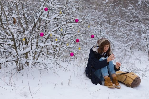 Teen girl on a winter walk on a snowy day christmas