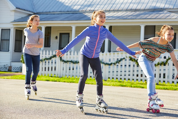 Teen girls group rolling skate in the street