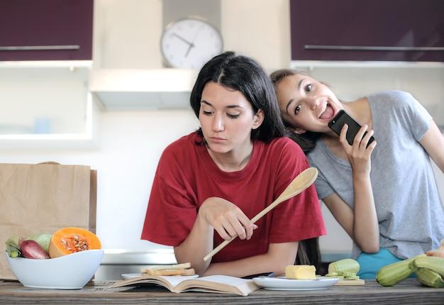 Teen girls making fun at home