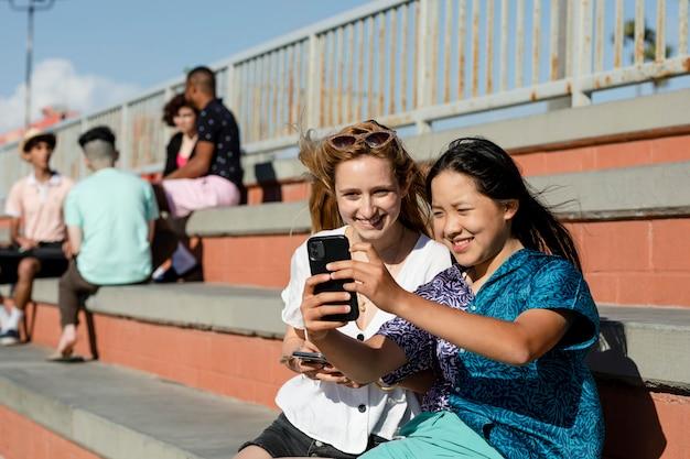 Teen girls watching viral videos, social media share