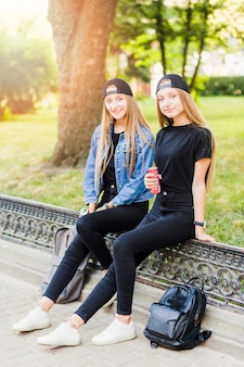 Teen girls with drinks looking at camera