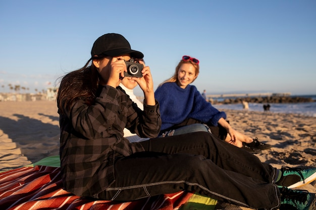 Teen hobby photography, friends taking photos at the beach