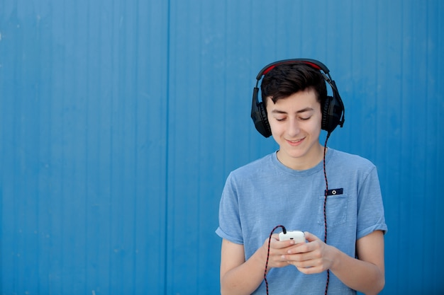 Teen listening to music with headphones