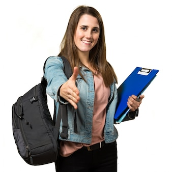 Teen student girl holding books and making a deal