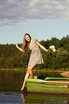 Teen with bouquet playing on the boat