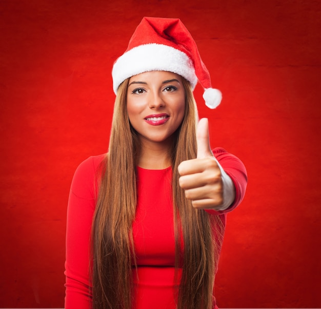 Teen with long hair and thumbs up