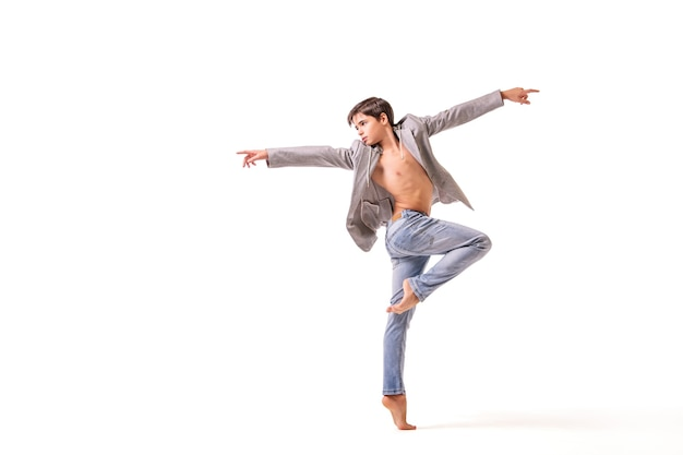 A teenage ballet dancer poses barefoot, isolated on a white background.