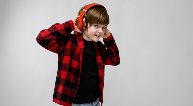 Teenage boy in fashionable clother and headphones