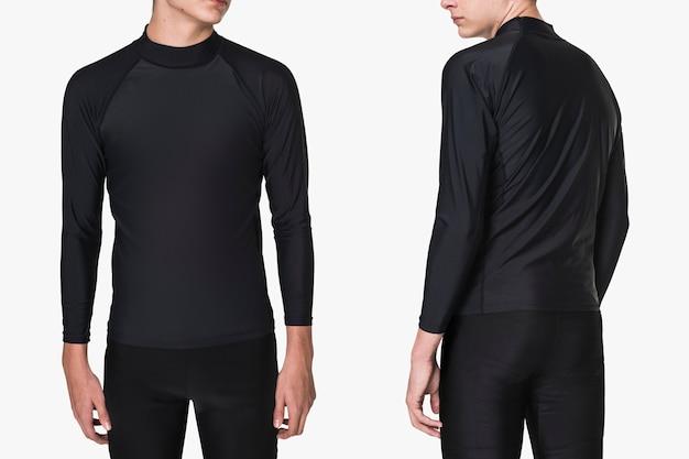 Подросток в опрометчивой одежде и шортах для купальных костюмов, вид сзади