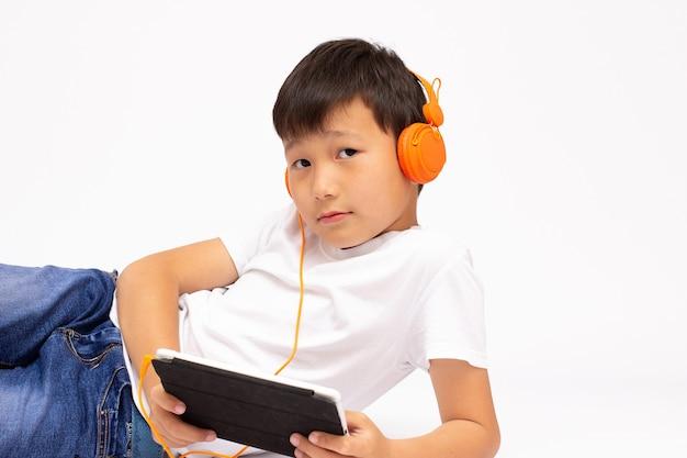 Teenage boy using tablet with headphones