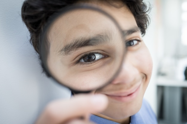 Teenage boy with magnifier