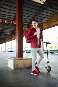 Teenage boy with scooter