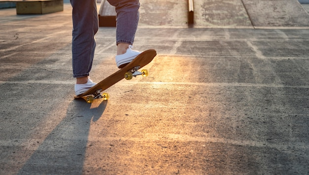 Teenage boy with skateboard close u