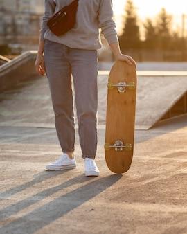 Teenage boy with skateboard close up